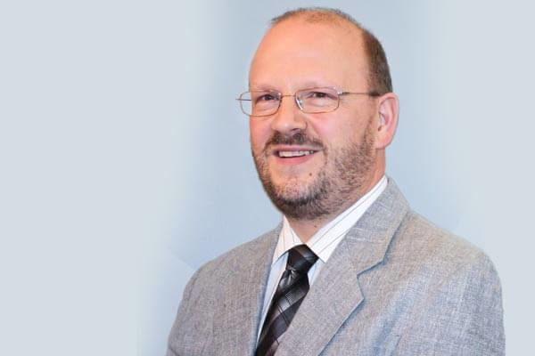 Porträtfoto von Dr. Andreas Henning, Schulzweigkoordinator Informatik